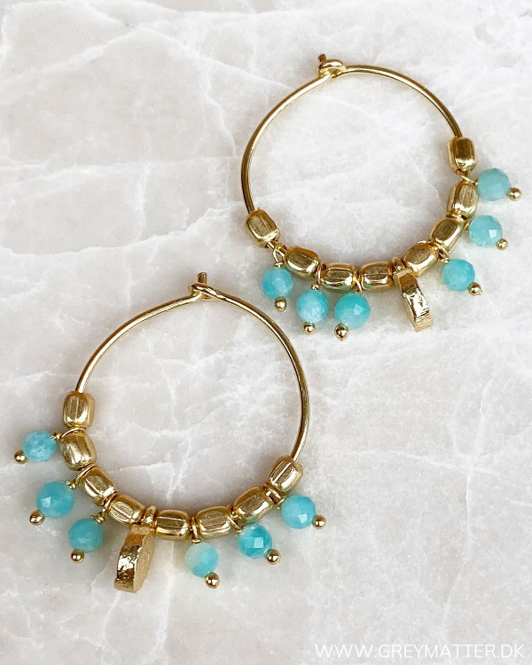 Festlige øreringe med blå sten